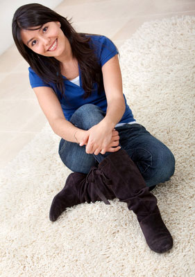 Woman Sitting on New Carpet After Remodeling Job Finished